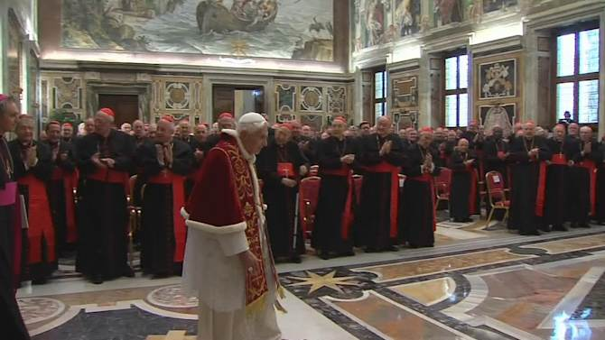 "In this image taken from video as Pope Benedict XVI enters to deliver his final greetings to the assembly of cardinals at the Vatican Thursday Feb. 28, 2013, before he retires in just a few hours.  Benedict urged the cardinals to work in unity and promised his ""unconditional reverence and obedience"" to his successor in his final words to his cardinals Thursday in a poignant and powerful farewell before he becomes the first pope in 600 years to resign. (AP Photo/Vatican TV)"