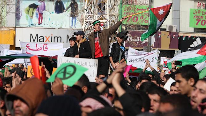 Demonstraters wave the Jordanian flag during a protest by the Muslim Brotherhood movement and other opposition parties against the upcoming parliamentary elections, in Amman, Jordan, Friday, Jan. 18, 2013. Friday's peaceful demonstration drew about 1,300 Muslim Brotherhood members and others, united in the election boycott and in demands that King Abdullah II cede some of his powers and give parliament more say in the country. The demonstration comes just five days before elections that will for the first time see a prime minister emerge from among the winning candidates, rather than by appointment by the king. (AP Photo/Mohammad Hannon)