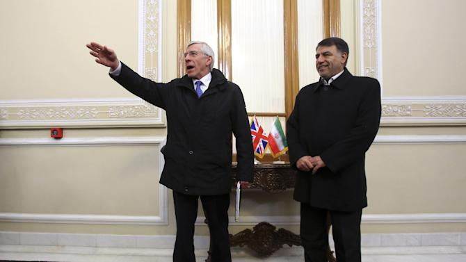 Britain's former Foreign Secretary Jack Straw, left, gestures at the start of his meeting with a group of Iranian parliamentarians led by Abbasali Mansouri, right, in Tehran, Iran, Tuesday, Jan. 7, 2014. A British Parliament delegation Tuesday arrived in Tehran, the first visit by U.K. lawmakers to Iran in years, the official IRNA news agency reported. IRNA, said Tuesday that the four-member delegation is headed by Straw, who last visited Iran in 2003 as Britain's top diplomat.(AP Photo/Vahid Salemi)
