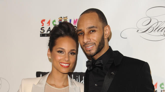 FILE - In this Nov. 3, 2011 file photo, Alicia Keys and Swizz Beatz attend the Keep A Child Alive's 8th annual Black Ball, in New York. Swanky, star-studded galas like the 26th Carousel of Hope on Saturday, Oct. 20, 2012, in Beverly Hills, and Alicia Keys' annual Black Ball next month at New York's Hammerstein Ballroom are stalwarts in the world of nonprofits. (AP Photo/Peter Kramer, File)