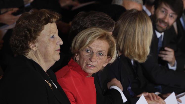 Foreign Minister Emma Bonino, right, shares a word with Justice Minister Anna Cancellieri during the swearing in ceremony of the new government at the Quirinale Presidential Palace, in Rome, Sunday, April 28, 2013. (AP Photo/Domenico Stinellis)