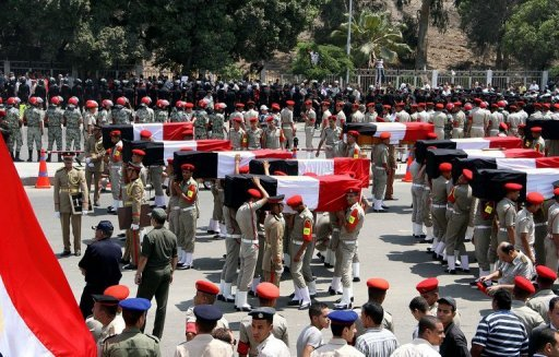 <p>Egyptian military police carry the coffins of 16 soldiers killed in an attack in Sinai during their funeral in Cairo on August 7. Egypt's military killed 20 militants in a helicopter strike in Sinai on Wednesday, state television reported, days after 16 of its soldiers were killed in an attack attributed to Islamic extremists</p>