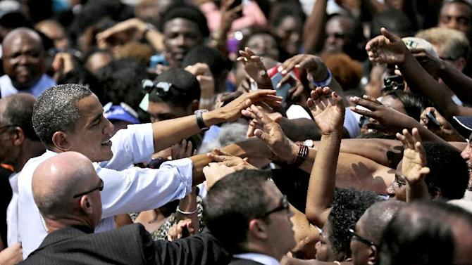 President Barack Obama greets supporter after speaking at a campaign event at Norfolk State University, Tuesday, Sept. 4, 2012, in Norfolk, Va. (AP Photo/Pablo Martinez Monsivais)