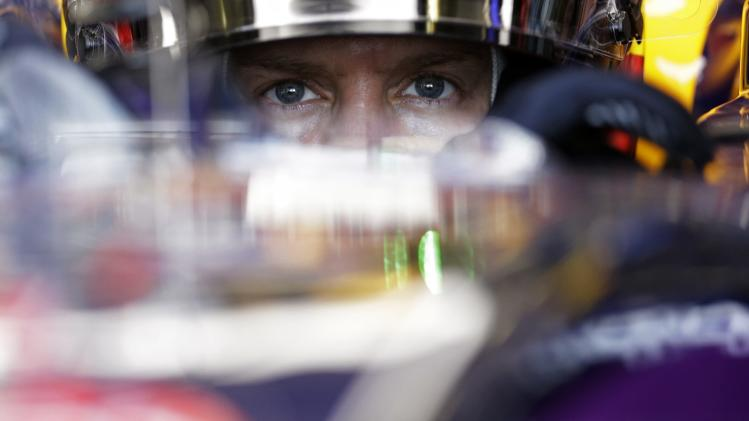 Red Bull Formula One driver Vettel of Germany concentrates as he sits in his car during the first free practice session of the Hungarian Grand Prix at the Hungaroring circuit