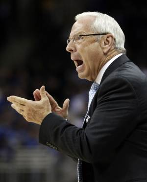North Carolina coach Roy Williams yells to his team during the first half of a second-round game against Villanova in the NCAA college basketball tournament at the Sprint Center in Kansas City, Mo., Friday, March 22, 2013. (AP Photo/Orlin Wagner)