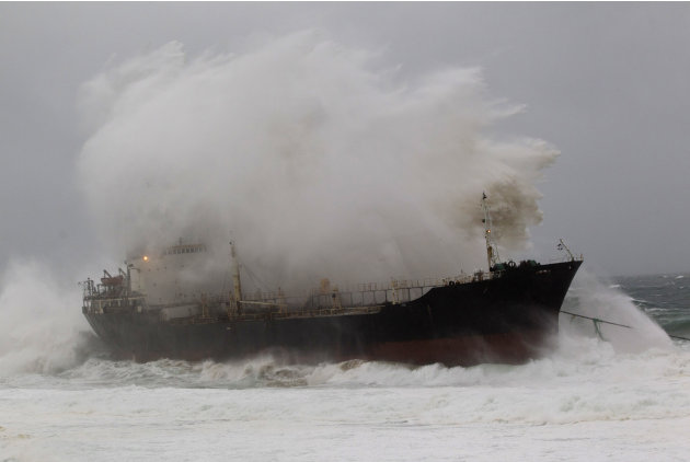 A wave crashes into a ship …