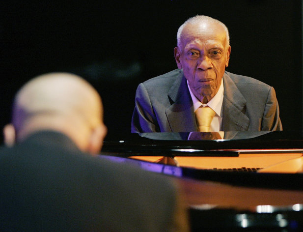 FILE - In this Oct. 9, 2008 file photo, Cuban pianist Bebo Valdes, right, and his son Chucho Valdes perform during a joint concert at the Casa de America in Madrid, Spain. Bebo Valdes died Friday, March 22, 2013 in Sweden, according to the Society of Spanish Authors without specifying the cause of death. He was 94. (AP Photo/Paul White, File)