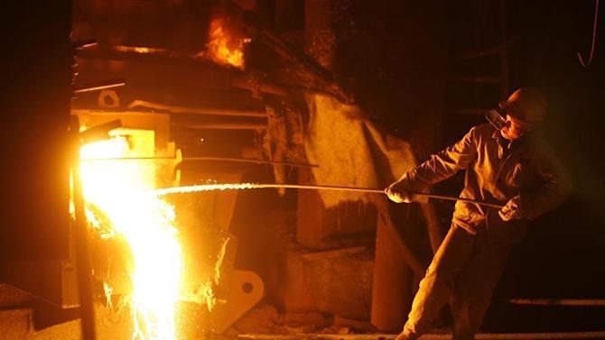 Employee works at iron and steel plant in Wuhan