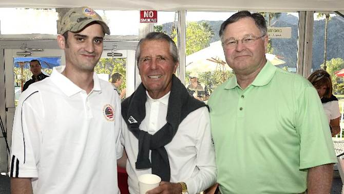 IMAGE DISTRIBUTED FOR HUMANA- Wounded warrior and U.S. military veteran Adam Sampson, left, golf legend and Humana well-being ambassador Gary Player, middle, and President of Humana Government Business Tim McClain share a smile at the Military Hospitality Tent during Military Appreciation Dayat the Humana Challengeon January 19, 2013, in La Quinta, Calif. The day featured a ceremony to honor members of the Armed Forces and their families and featured inspirational messages from military leaders, a color guard and a flyover.The Humana Challenge is being played Jan 14-20 in La Quinta. (Rodrigo Pena / AP Images for Humana)