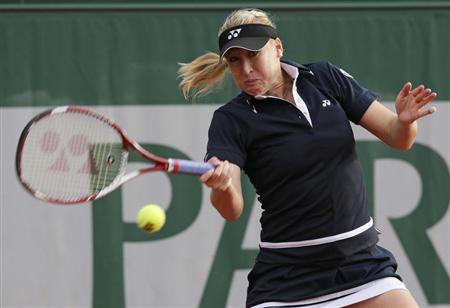 Baltacha of Britain hits a return to Erakovic of New Zealand during their women's singles match at the French Open tennis tournament in Paris