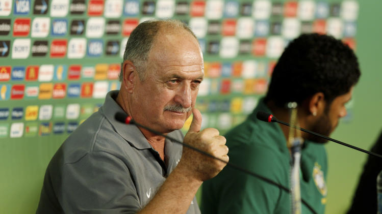 Brazil head coach Luiz Felipe Scolari, left,  gestures next to Hulk duringa news conference in Fortaleza, Brazil, Tuesday, June 18, 2013. Brazil will face Mexico at the soccer Confederations Cup. (AP Photo/Fernando Llano)