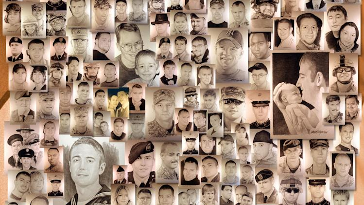 This image shows a detail of a poster featuring dozens of hand-drawn portraits of men and women killed at war by artist Michael Reagan. Since starting the Fallen Heros Project in 2004, Reagan has drawn more than 3,000 portraits and given them free-of-charge to families of fallen soldiers. (AP Photo/Michael Reagan)