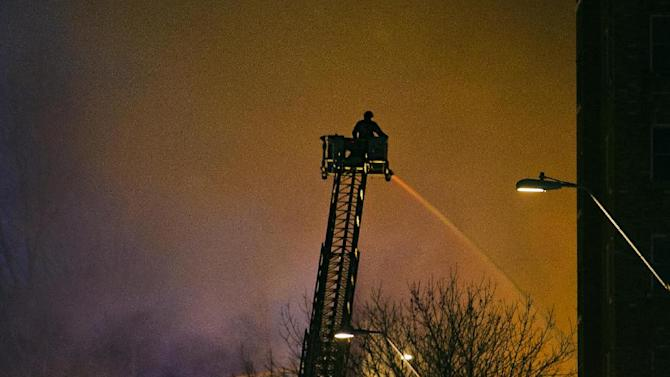 Firefighters battle a massive fire Tuesday night, Feb. 19, 2013 at the Country Club Plaza in Kansas City, Mo. A car crashed into a gas main in an upscale Kansas City shopping district, sparking a massive blaze that engulfed an entire block and caused multiple injuries, police said. (AP Photo/The Kansas City Star, Allison Long) KANSAS CITY OUT