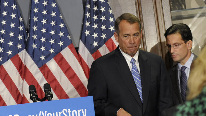 FILE - In this Oct. 23, 2013, file photo House Speaker John Boehner of Ohio, left, and House Majority Leader Eric Canton of Va., right, leave after a news conference, following a meeting at the Republican National Committee offices on Capitol Hill in Washington. A year after losing a presidential race many Republicans thought was winnable, the GOP arguably is in worse shape than before, struggling to control tensions between its tea party and establishment wings, and watching the party's approval ratings hit record lows. (AP Photo/Susan Walsh, File)