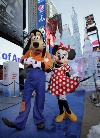 "Disney characters Goofy and Minnie Mouse pose in front of a three-story castle made of ice in New York's Times Square, Wednesday, Oct. 17, 2012. On Wednesday, Disney announced a new program for 2013, ""Limited Time Magic,"" in which guests will encounter surprise weekly themes at Disney parks in Florida and California. The program was described as ""52 weeks of magical experiences big and small that appear, then disappear as the next special surprise debuts."" For example, a weeklong Valentine's Day celebration might include pink lighting on Disney castles, surprise meet-and-greets with Disney characters and candlelit dinners for lovebirds. (AP Photo/Richard Drew)"