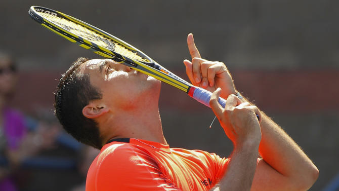 Spain's Nicolas Almagro reacts after winning his match against Jack Sock in the third round of play at the 2012 US Open tennis tournament,  Saturday, Sept. 1, 2012, in New York. (AP Photo/Paul Bereswill)