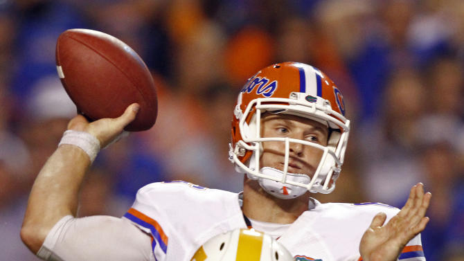 Florida quarterback Jeff Driskel (6) throws a pass as Tennessee defensive back Eric Gordon (24) closes in during the fourth quarter of an NCAA college football game on Saturday, Sept. 15, 2012, in Knoxville, Tenn. Florida won 37-20. (AP Photo/Wade Payne)