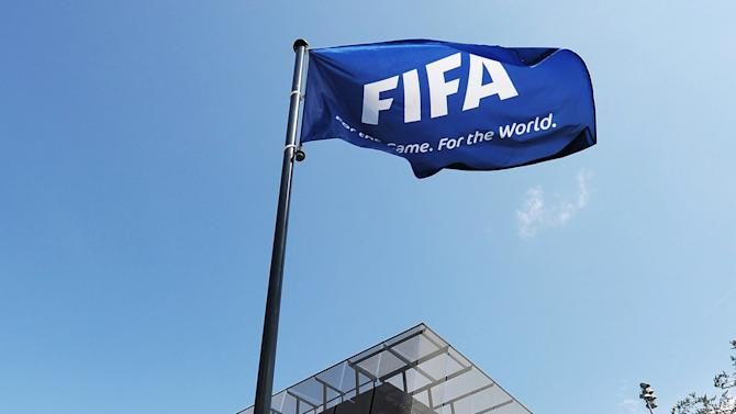 A flag flies in front of the  Headquarters of the international Soccer association FIFA in Zurich, Switzerland, Monday, July 16, 2012. FIFA's executive committee will hold a special meeting tomorrow July 17 to confirm the nominations for chairmen of the two chambers of its recently-reformed ethics committee.  (AP Photo/Keystone/Steffen Schmidt)