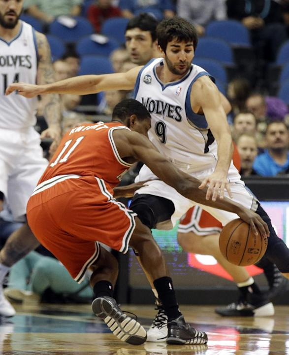 Milwaukee Bucks' Brandon Knight, left, tries to get control of the ball as Minnesota Timberwolves' Ricky Rubio of Spain defends in the first quarter of an NBA basketball game, Tuesday, March 1