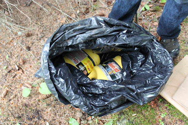 This undated photo provided by the FBI shows bottles of Drano found inside a plastic bag in Eagle River, Alaska, just north of Anchorage. The FBI says confessed Alaska serial killer Israel Keyes, who