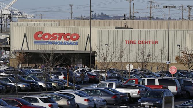 In this Tuesday, Nov. 24, 2015, file photo, cars fill the parking lot of a Costco store in Seattle. A California farm is recalling a vegetable mix believed to be the source of E.coli in Costco chicken salad that has been linked to an outbreak that has sickened several people in multiple states, the Food and Drug Administration said Thursday, Nov. 26. (AP Photo/Ted S. Warren, File)