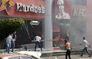 Lebanese men ransack US fast food chains Hardee&#39;s and KFC as they protest against the controversial film &quot;Innocence of Muslims&quot; in the northern Lebanese city of Tripoli