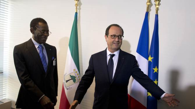 France's President Francois Hollande meets Equatorial Guinea President Teodoro Obiang Nguema before a meeting on the sidelines of the U.N. General Assembly in New York