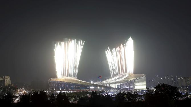 Fireworks explode over the Incheon Asiad Main Stadium during the opening ceremony of the 17th Asian Games