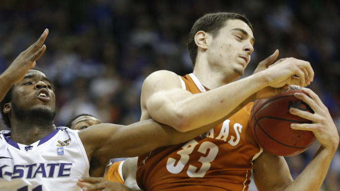 Texas forward Ioannis Papapetrou (33) rebounds against Kansas State forward Nino Williams (11) during the second half of an NCAA college basketball game in the Big 12 tournament on Thursday, March 14, 2013, in Kansas City, Mo. Kansas State defeated Texas 66-49. (AP Photo/Orlin Wagner)