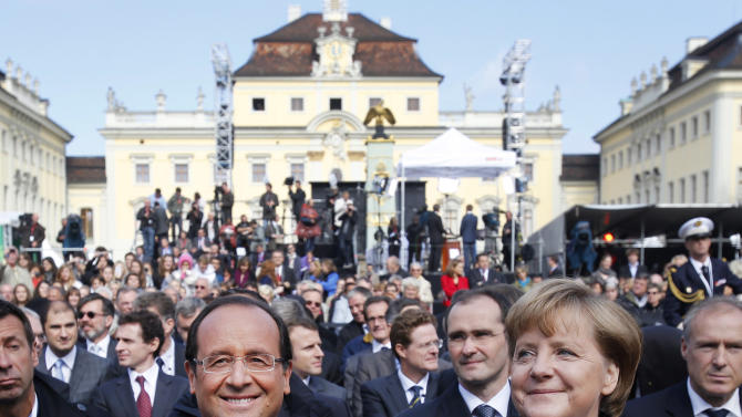 German Chancellor Angela Merkel, right, and French President Francois Hollande, at the castle in Ludwigsburg, Germany, Saturday, Sept. 22, 2012.  The leaders of France and Germany are meeting to celebrate an anniversary of their countries' reconciliation following the end of World War II. French President Francois Hollande travelled to the southwestern German city of Ludwigsburg on Saturday to meet with Chancellor Angela Merkel to commemorate the speech France's then-leader Charles de Gaulle gave there 50 years ago.  (AP Photo/Michael Probst)