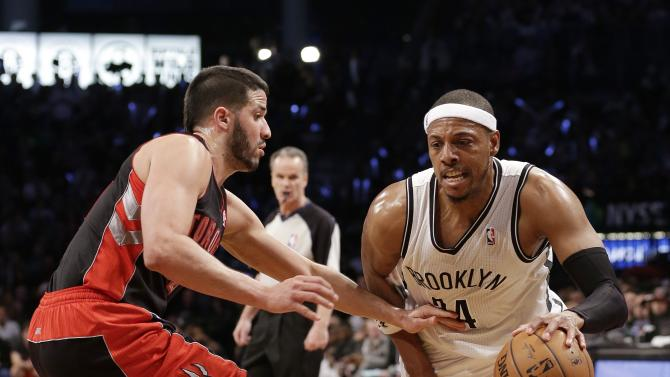 Toronto Raptors' Greivis Vasquez defends Brooklyn Nets' Paul Pierce (34) during the second half of Game 3 of an NBA basketball first-round playoff series Friday, April 25, 2014, in New York. The Nets won 102-98. (AP Photo/Frank Franklin II)