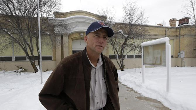 Spring City Councilman Neil Sorensen stands in front of the City Hall Tuesday, Jan. 8, 2013, in Spring City, Utah. Officials in a small Utah town are urging citizens and teachers to arm themselves for everyone's safety against any aggressor. One member of the Spring City council wants to make the edict mandatory, but police are urging restraint. Councilman Neil Sorensen says he's drafting a measure that will go before the full council in February. At first, Sorensen wanted to mandate a gun in every household in the town of 1,000. But the Sanpete County sheriff didn't think it was a good idea to force households to own guns, so Sorensen says he's inclined to make it a recommendation, not a law. (AP Photo/Rick Bowmer)
