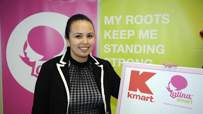 Kmart Latina Smart Fund scholarship winner, Odalis Lopez, poses with her check at a ceremony, Thursday, March 1, 2012, in College Park, Md. Lopez, a freshman and communications major at the University of Maryland at College Park, was awarded the $10,000 first prize scholarship. (Nick Wass/AP Images for Kmart)