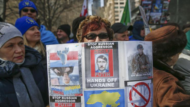 People demonstrate in support of Ukraine outside the United Nations headquarters in New York