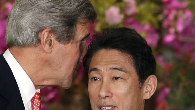 U.S. Secretary of Sate John Kerry, left, whispers to Japanese Foreign Minister Fumio Kishida after their joint press conference at Foreign Ministry's Iikura Guesthouse in Tokyo, Sunday, April 14, 2013. Kerry and Kishida said their countries are committed to new talks with North Korea if the reclusive communist government begins abiding by previous agreements on its nuclear program. (AP Photo/Shizuo Kambayashi)