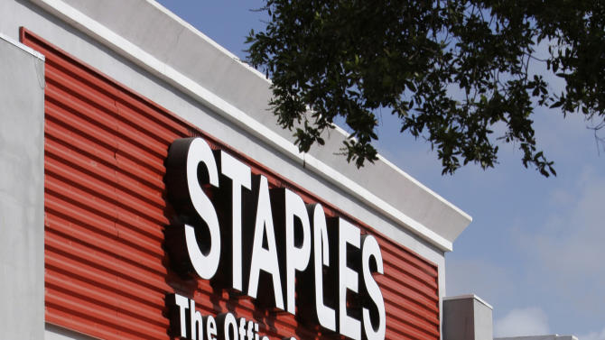 FILE-This Tuesday, Nov. 15, 2011, file photo, shows a  Staples office supply store in Miami. Staples is speeding up the closure of about 15 of its U.S. stores and plans to close 45 stores and some delivery businesses in Europe. The office products company also said Tuesday, Sept. 25, 2012, it will invest more in its online and mobile efforts and will expand the product assortment that it offers to its business customers. (AP Photo/ Lynne Sladky)