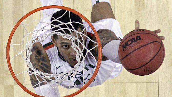 Miami's Rion Brown goes up for a shot during the first half of a second-round game of the NCAA college basketball tournament against the Pacific Friday, March 22, 2013, in Austin, Texas.  (AP Photo/David J. Phillip)