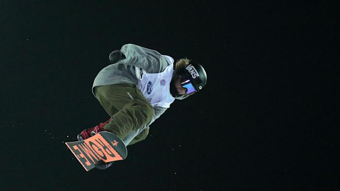 Erica Willet of USA performs during the final of  Big Air Snowboard World Cup on the campus of Istanbul Technical University, ITU, in Istanbul, Turkey, Saturday, Dec. 20, 2014. Istanbul host the first-ever World Cup on Turkish soil but also the first-ever Big Air event for both, men and women.(AP Photo)