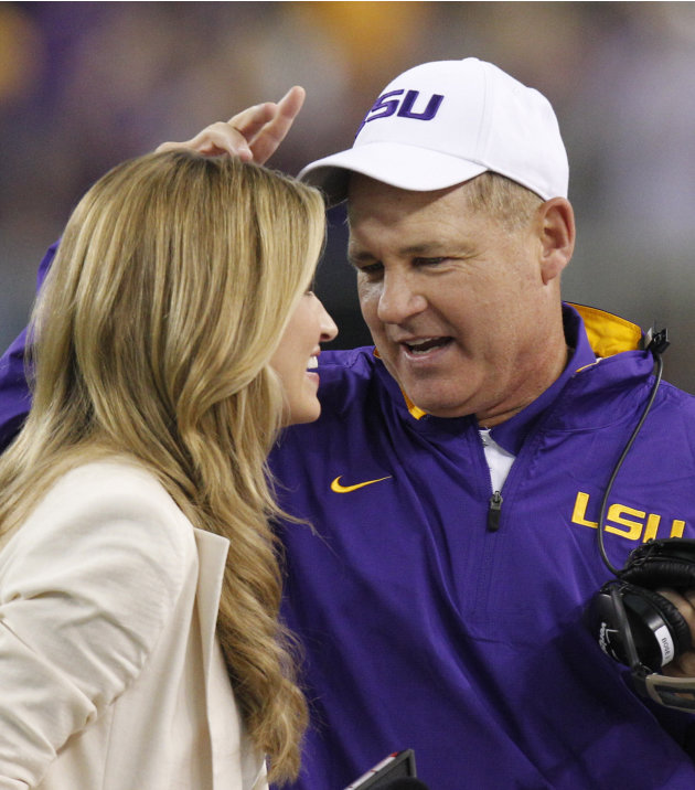 LSU head coach Les Miles, right, talks with ESPN reporter Erin Andrews during the first half of the Cowboys Classic NCAA college football game agianst Oregon, Saturday, Sept. 3, 2011, in Arlington, Te