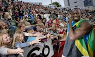 Young spectators cheer and try to touch Jamaican sprinter Usain Bolt after he won the men's 100m at the Diamond League athletics meeting at Bislett Stadium in Oslo on June 7. Alcohol use has been ruled out as the cause of a one-vehicle accident from which global sprint star Bolt walked away uninjured, Jamaican police have revealed