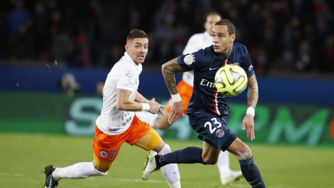 Paris Saint Germain's Gregory Van der Wiel fights for the ball with Montpellier's Anthony Mounier during their French Ligue 1 soccer match at Parc des Princes stadium in Paris
