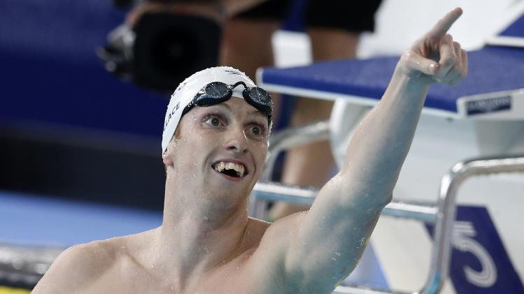 Scotland's Wallace celebrates winning the Men's 400m Individual Medley Final at the 2014 Commonwealth Games in Glasgow, Scotland,