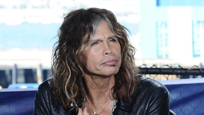 """This Oct. 10, 2011 photo released by Fox shows """"American Idol"""" judge Steven Tyler during auditions for the singing competition series in San Diego. Tyler, who quit the show, admits he liked the paychecks, but had a love-hate relationship with the show. In an interview with Rolling Stone, Tyler says the series is """"not my cup of tea.""""  Tyler tells the magazine he took the job because it was a good way to pass the time while he and his band mates worked out their behind-the-scenes conflicts. He also says he didn't have it in him to be negative to contestants. (AP Photo/Fox, Michael Becker)"""