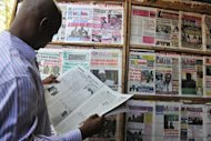 A man reads a local newspaper on April 4, in Bamako. Several people were killed in a gunfight Monday between Mali coup troops and the presidential guard loyal to ousted leader Amadou Toumani Toure at the national TV and radio station, said employees