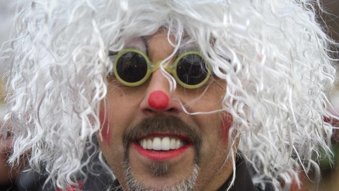 Clown poses for a portrait before the Macy's Thanksgiving Day Parade, in New York