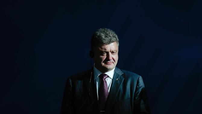 Ukraine president-elect Petro Poroshenko attends a joint news conference with German Chancellor Angela Merkel, prior to a meeting at the chancellery in Berlin, Thursday, June 5, 2014. (AP Photo/Markus Schreiber)