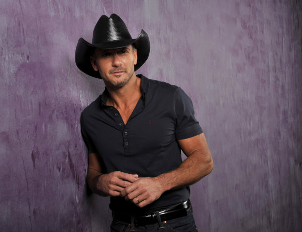 This Jan. 15, 2013 photo shows country singer and actor Tim McGraw in Nashville, Tenn. His latest album, &quot;Two Lanes of Freedom,&quot; will be released on Tuesday, Feb. 5. (Photo by Donn Jones/Invision/AP)