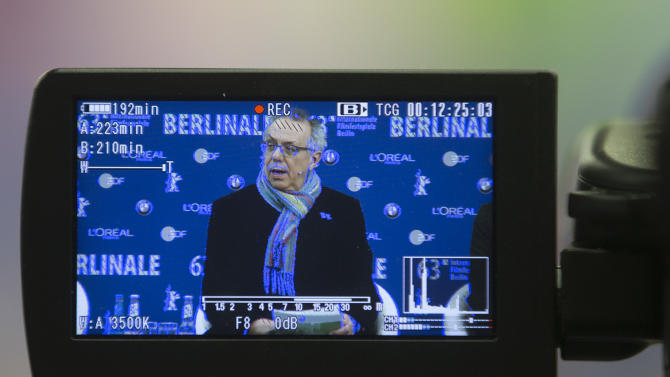 Dieter Kosslick,  director of the International Film Festival Berlin, the Berlinale is seen on the screen of an television camera as he attends the annual program press conference in Berlin, Monday, Jan. 28, 2013. The 63. Berlinale festival  will take place  from Feb. 7, until Feb. 17, 2013 in Berlin.  (AP Photo/Markus Schreiber)