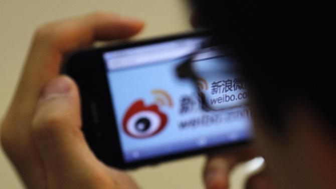 File photo of a man visiting Sina's Weibo microblogging site in Shanghai