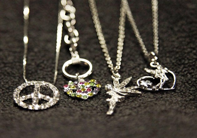 This Oct. 10, 2012, photo shows jewelry containing high levels of the toxic metal cadmium purchased by The Associated Press at small shops in Los Angeles during a 19-month period ending in March 2012. Federal regulators failed to pursue recalls after they found cadmium-tainted jewelry on store shelves, despite their vow to keep such toxic trinkets out of children&#39;s hands, an AP investigation shows. (AP Photo/Reed Saxon)